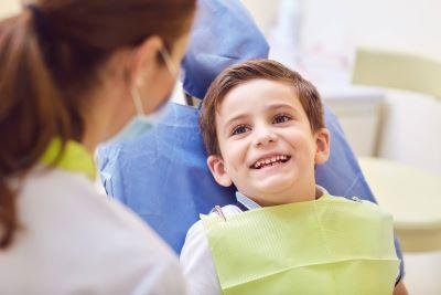 Young boy smiling at dental exam with our Chico, CA pediatric dentist