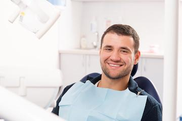 Man smiling in dental chair at our Chico CA Dentist Office