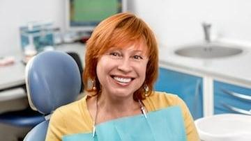 Older woman smiling in dental chair | Periodontal Treatment in Chico CA