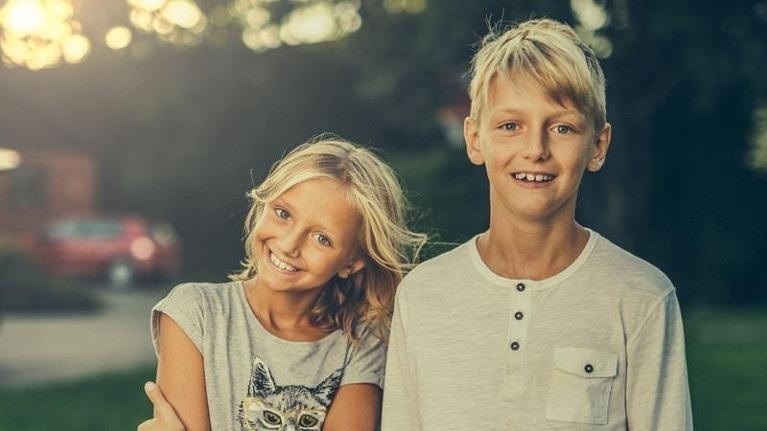 Smiling young brother and sister | South Chico Dental Care | Pediatric Dentistry in Chico CA